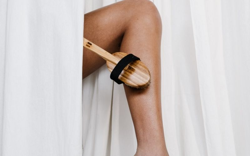 Exfoliate your legs with a brush